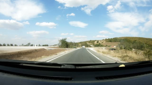 pov driving on a rural road in a mountain national park in the afternoon, in summer. - pine woodland stock videos & royalty-free footage