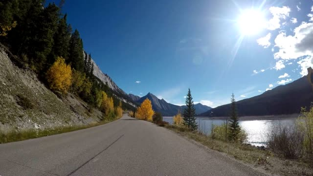 driving on beautiful canadian road - driver's seat stock videos and b-roll footage