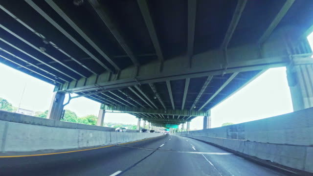 driving on belt parkway near by kosciuszko bridge, brooklyn, new york - windshield stock videos & royalty-free footage