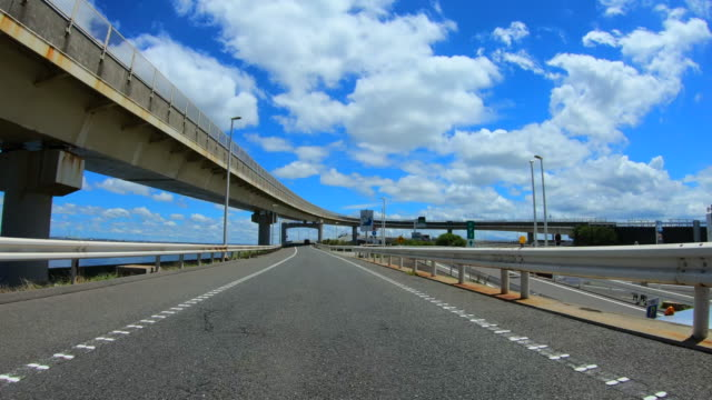 driving on bridge with clouds - plusphoto stock videos & royalty-free footage