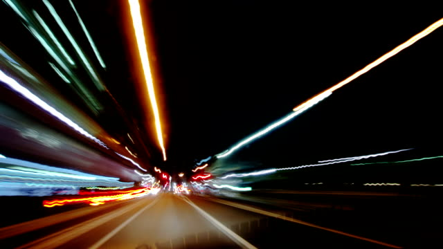 pov t/l driving on busy city streets at night. - time lapse stock videos & royalty-free footage