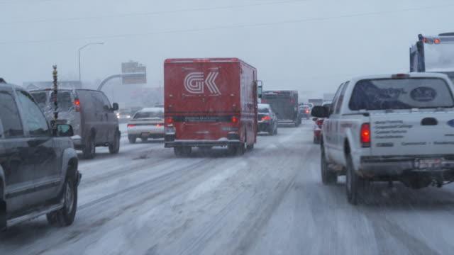 pov driving on busy snowy road, orem, utah, usa - orem video stock e b–roll