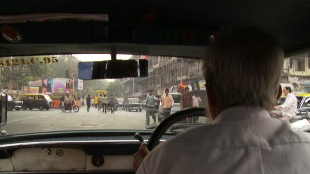 pov driving on busy street / mumbai, india - mumbai stock videos & royalty-free footage