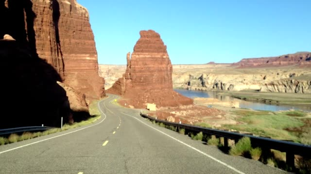 driving on canyon road - red rocks stock-videos und b-roll-filmmaterial