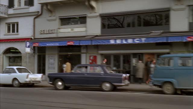 1966 side pov driving on city street / zurich, switzerland - switzerland stock videos & royalty-free footage