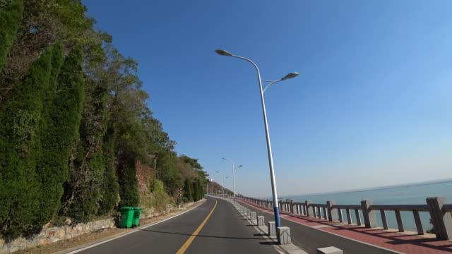 driving on coastal road - jiangsu province stock videos & royalty-free footage