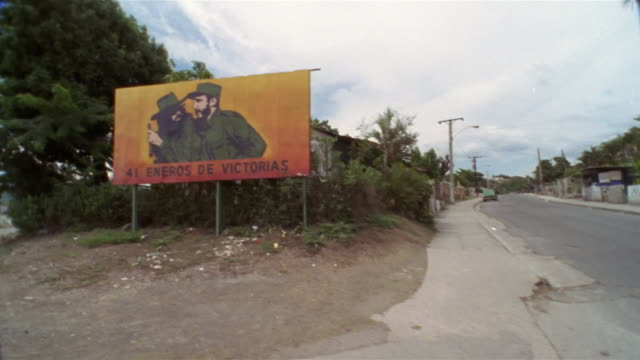 side pov driving on country road, passing che guevara and fidel castro revolutionary billboard, santiago de cuba, cuba  - government stock videos & royalty-free footage