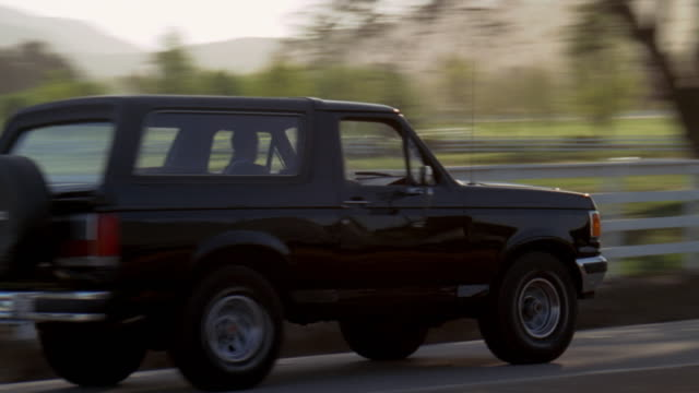 stockvideo's en b-roll-footage met cs, ts, suv driving on country road - sports utility vehicle