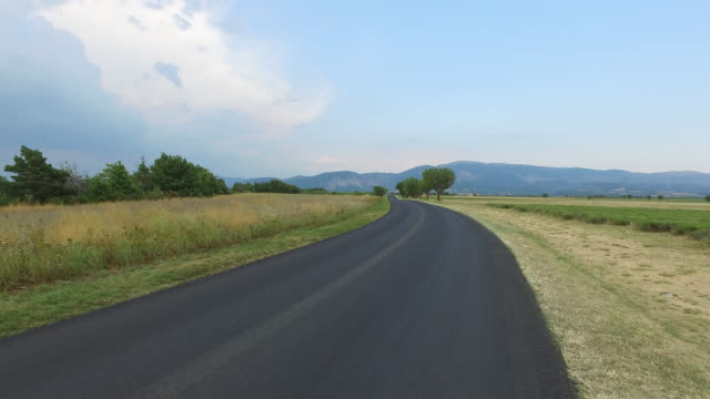 pov driving  on countryside road - tarmac stock videos & royalty-free footage