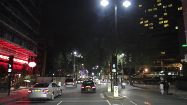pov driving on cromwell road, passing by natural history museum at night / london, united kingdom - point of view stock videos & royalty-free footage