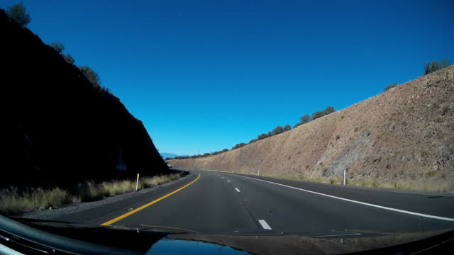 Driving on curved mountain road in the US