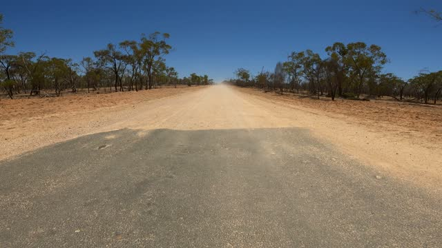 driving on dirt and asphalt country road, car point of view, outback australia - rear view stock videos & royalty-free footage