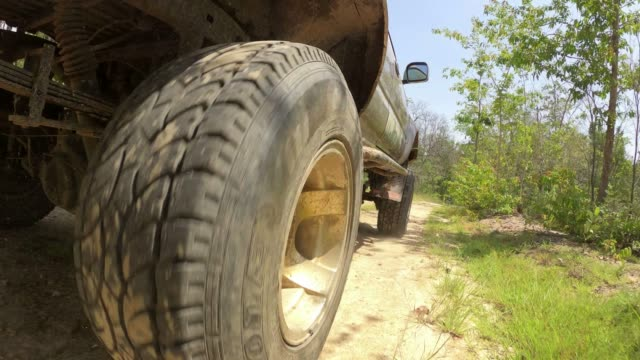 driving on dirt road in to the forest, car suspension - sports utility vehicle stock videos & royalty-free footage