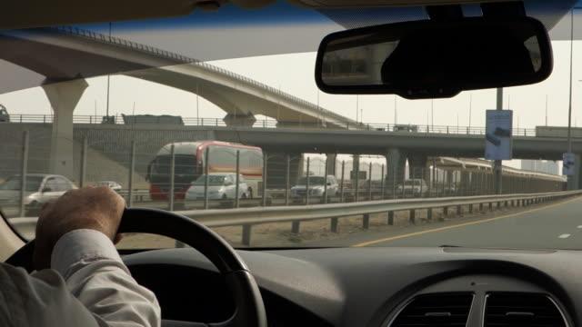 driving on dubai highway - crisscross stock videos & royalty-free footage