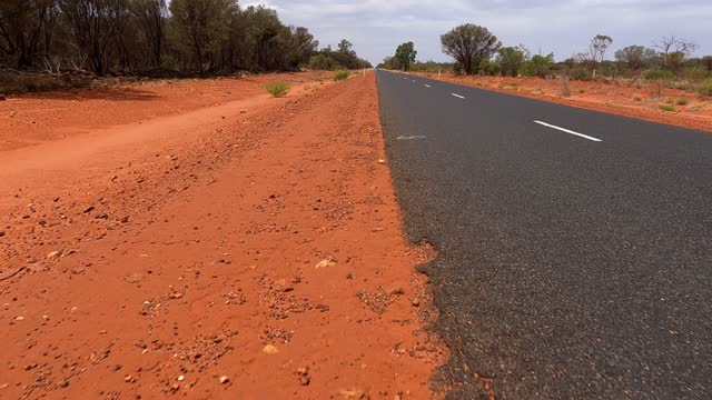 driving on empty country highway at the edge of roadside, rural australia - scenics stock videos & royalty-free footage