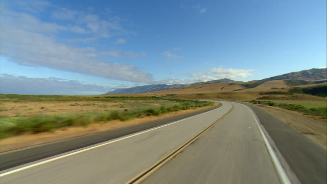 pov driving on empty highway u.s. 1 in los padres national forest, gorda, california, usa - distant stock videos & royalty-free footage