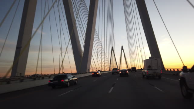 driving on fred hartman bridge at sunset - cable stayed bridge stock videos & royalty-free footage