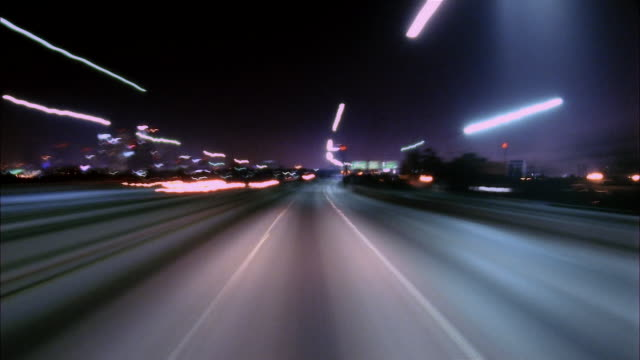 t/l, pov, driving on freeway at night, los angeles, california, usa - vanishing point stock videos & royalty-free footage
