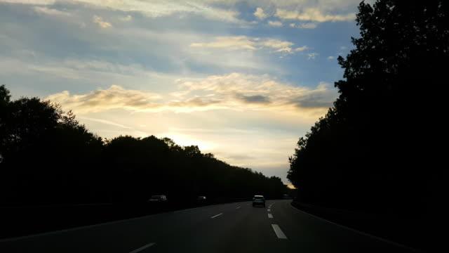 Driving On German Autobahn At Sunset