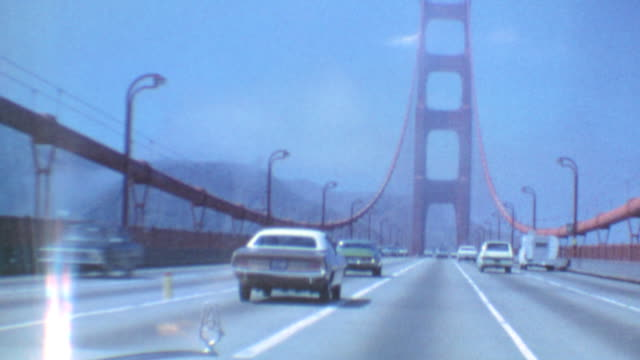Driving on Golden Gate Bridge / Signage for Sausalito / Tourism and Shopping / View of Bay and Queen Anne Homes / Golden Gate Bridge Area on August...