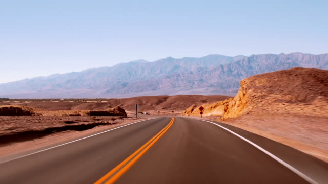 stockvideo's en b-roll-footage met driving on highway 190, time lapse - death valley national park