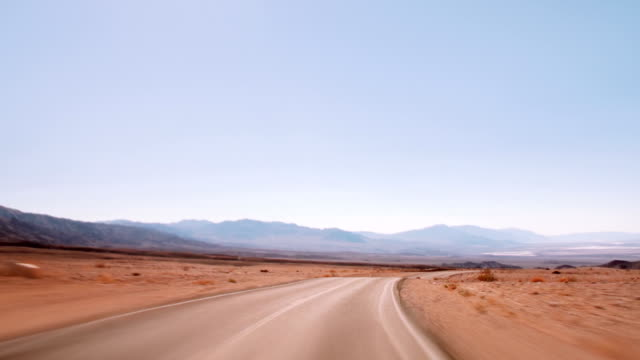driving on highway 190 - death valley national park stock videos and b-roll footage