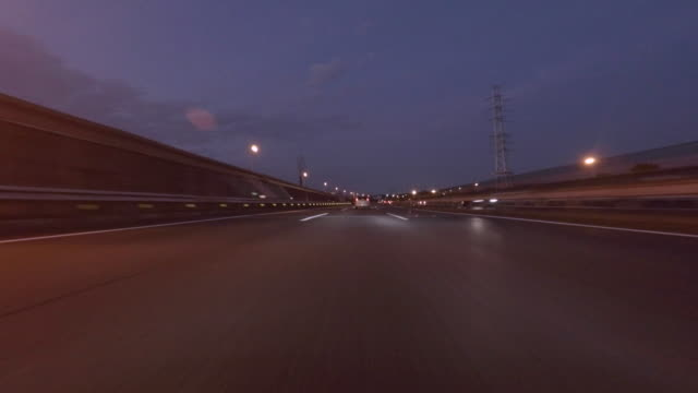 driving on highway at dusk - 4k- - plusphoto stock videos & royalty-free footage