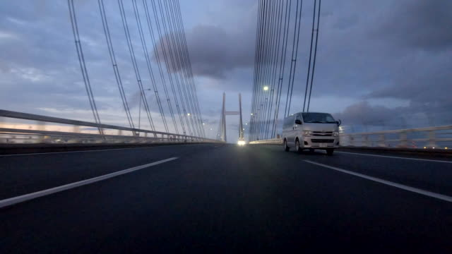 driving on highway at dusk / rear view - low angle view stock videos & royalty-free footage