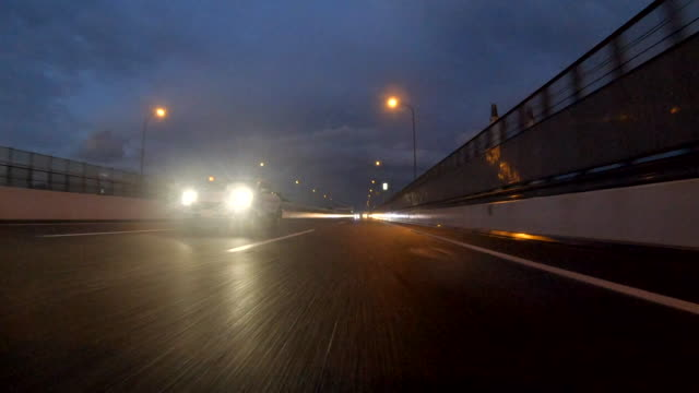driving on highway at dusk / rear view - headlight stock videos & royalty-free footage