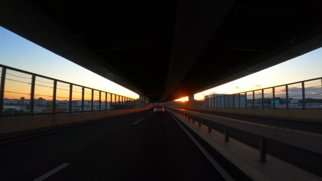driving on highway at dusk - passenger point of view stock videos & royalty-free footage