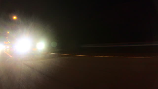 driving on highway at night - headlight stock videos & royalty-free footage