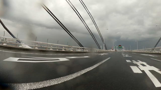 driving on highway at rainy day - low angle view stock videos & royalty-free footage