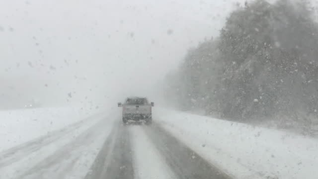 driving on highway during snow storm - condition stock videos & royalty-free footage