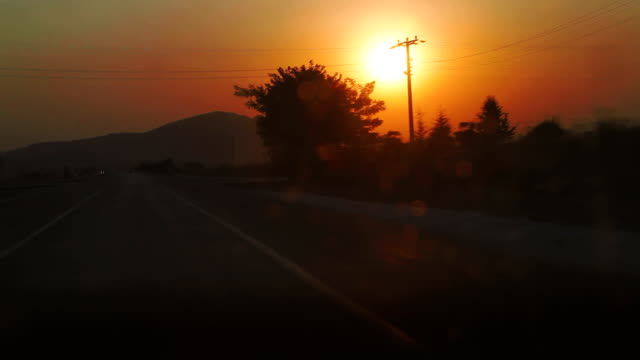 Driving on highway during sunrise