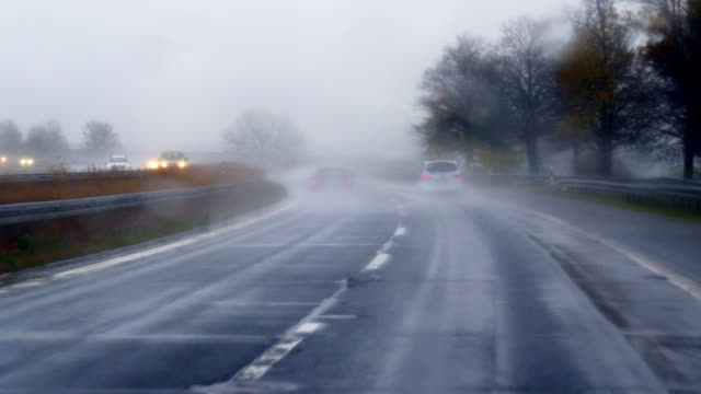 Driving On Highway In Rain