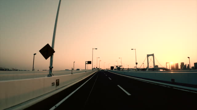 driving on highway / sunset / rainbow bridge - plusphoto stock videos & royalty-free footage
