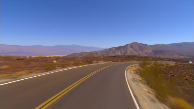 stockvideo's en b-roll-footage met pov, driving on highway through death valley national park, california, usa - death valley national park