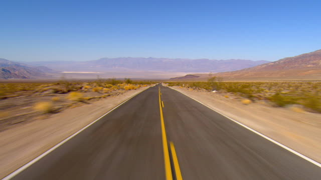 pov, driving on highway through death valley national park, california, usa - vanishing point stock videos & royalty-free footage