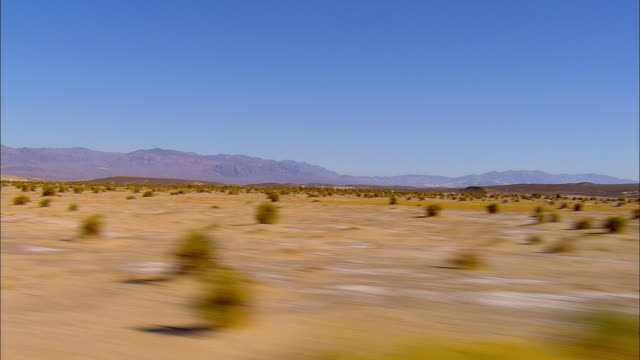 side pov, driving on highway through death valley national park, california, usa - death valley national park stock videos & royalty-free footage