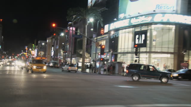 vidéos et rushes de rear pov driving on hollywood boulevard at night, hollywood, california, usa - hollywood boulevard