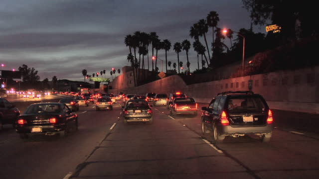 POV Driving on Hollywood Freeway 101 at dusk, Los Angeles, California, USA