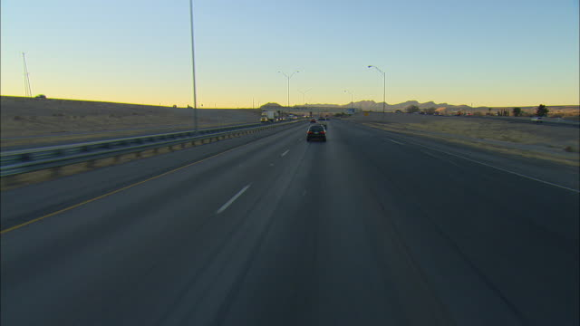 POV Driving on interstate highway at sunrise, El Paso, Texas, USA