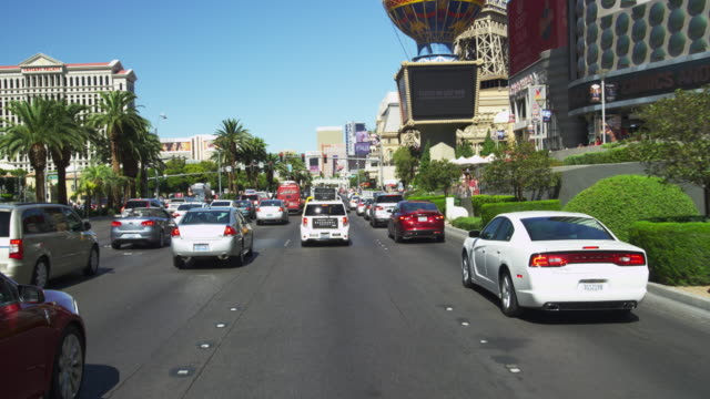 driving on las vegas blvd. in slow motion. - las vegas stock videos & royalty-free footage