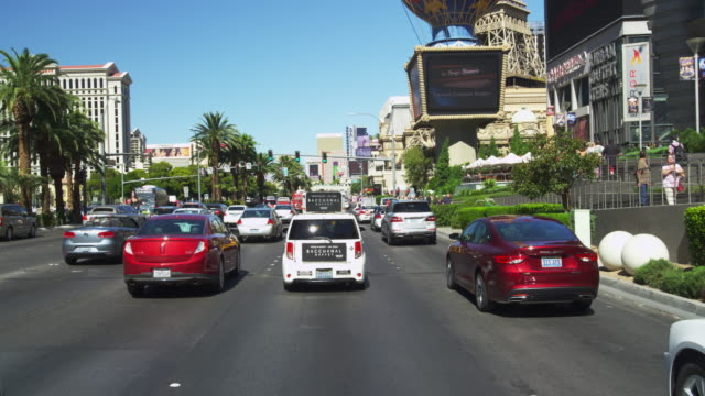 driving on las vegas blvd. in slow motion. - boulevard stock videos & royalty-free footage
