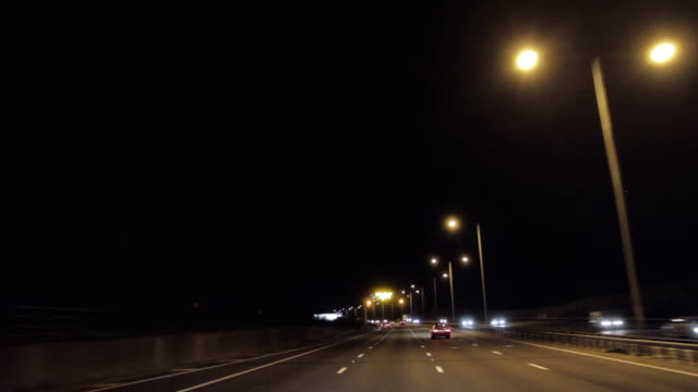 pov driving on m25 motorway with 'delays' flashing signs at night / london, united kingdom - personal land vehicle stock videos & royalty-free footage