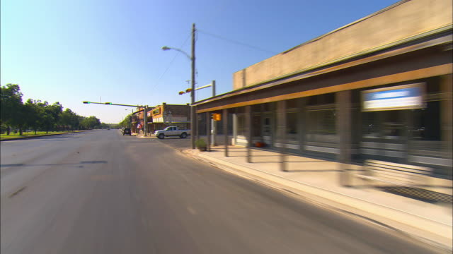 pov, driving on main street albany, texas, usa - small town stock videos and b-roll footage