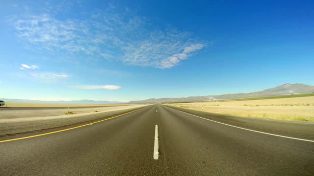 ws pov driving on mojave freeway - horizon over land stock videos & royalty-free footage