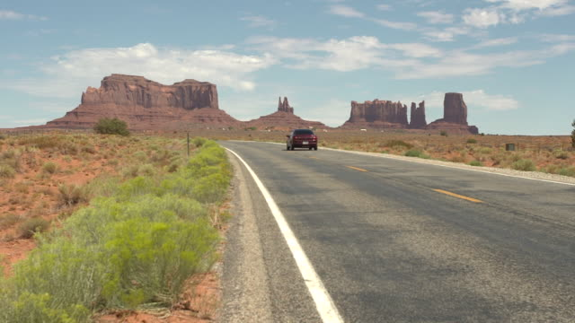 driving on monument valley country road - monument valley stock videos & royalty-free footage