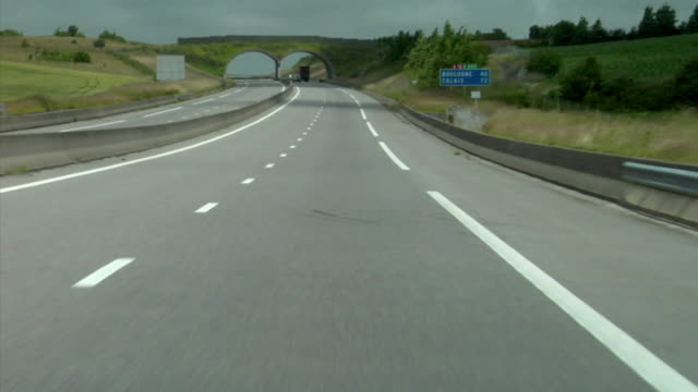 pov, driving on motorway, normandy, france - sign stock videos & royalty-free footage