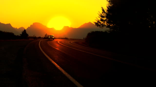 Driving on mountain road at Sunset